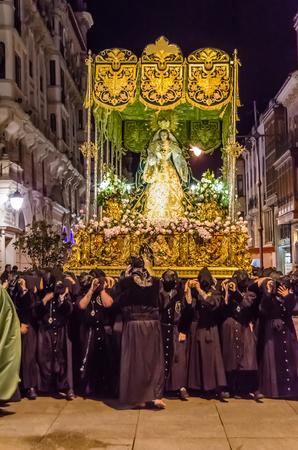 PALENCIA, SPAIN - MARCH 24, 2016: Traditional Spanish Holy Week (Semana Santa) procession on Holy Thursday night in the streets of Palencia (Castilla y Leon), Spain Standard-Bild - 97817089