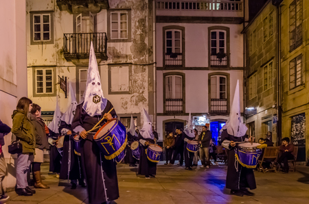 SANTIAGO DE COMPOSTELA, SPAIN - APRIL 3, 2015: Traditional Spanish Holy Week (Semana Santa) procession on Holy Thursday night in the streets of Santiago de Compostela (Galicia), Spain