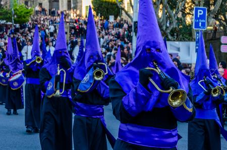 SANTIAGO DE COMPOSTELA, SPAIN - APRIL 3, 2015: Traditional Spanish Holy Week (Semana Santa) procession on Holy Friday in the streets of Santiago de Compostela (Galicia), Spain