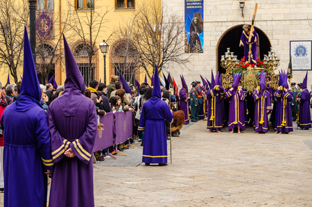 PALENCIA, SPAIN - MARCH 25, 2016: Traditional Spanish Holy Week (Semana Santa) procession on Holy Friday in the streets of Palencia (Castilla y Leon), Spain
