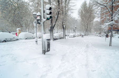 """MADRID, SPAIN – JANUARY 9, 2021: Streets of Madrid blanketed with the heaviest snowfall in 50 years, during Storm """"Filomena"""""""