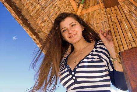 Beautiful girl standing on the beach Stock Photo - 3340904