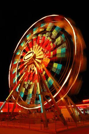 wheel spin: Blurry motion of Ferris Wheel Stock Photo