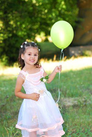 Little bridesmaid holding balon Stock Photo