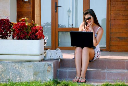 Business woman in front of her house Stock Photo - 3535262