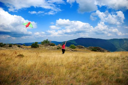 Fly the kite on the top of the mountain Stock Photo - 3669291