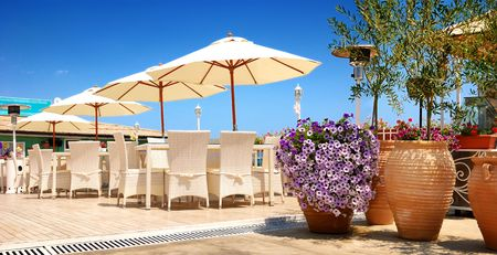 sunshades: Beach restaurant, chairs and sunshades outdoor