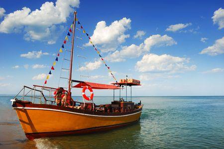 Orange, lonely Boat in Caribbean