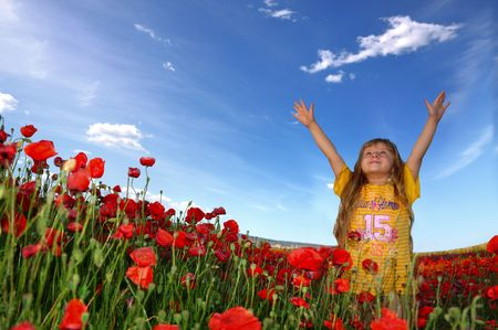 Little girl trying to touch the sky