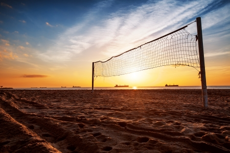 Sillhouette of a volleyball net and sunrise on the beach Stock Photo - 18335758