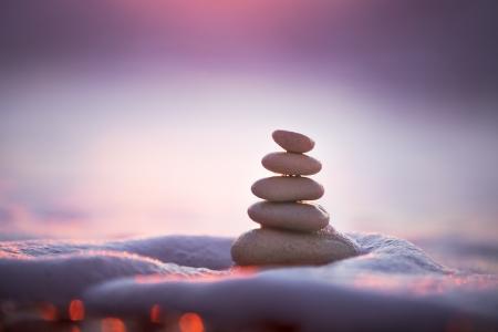 Stones balance on beach, sunrise shot Stock Photo