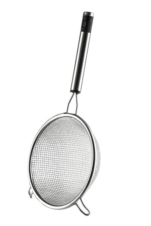 strainer: Round metal strainer isolated on white background