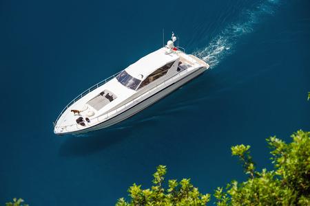 Yacht sailing in Mediterranean Sea near French Riviera and Monaco photo