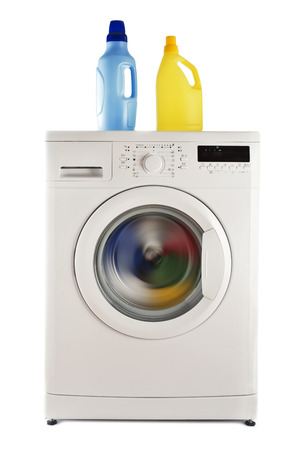 Washing machine with clothes and detergents studio isolated  Archivio Fotografico