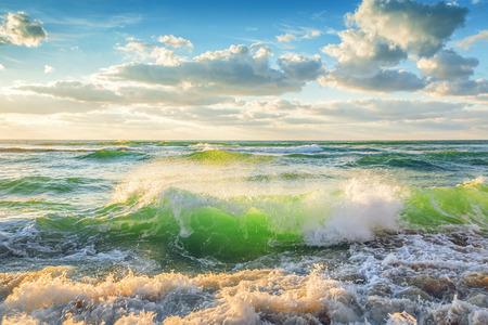 Crashing waves, sunrise shot photo
