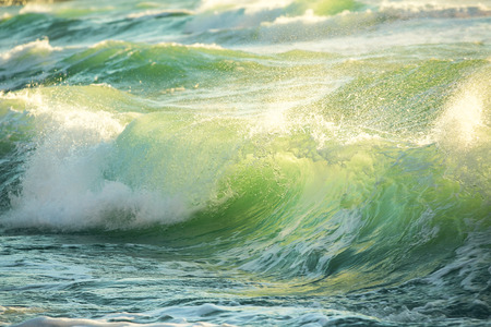 breaking down: Rough colored ocean wave breaking down, sunrise shot Stock Photo