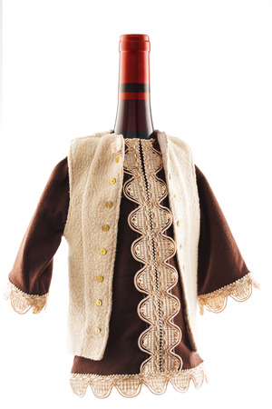 boyar: Red wine bottle dressed in traditional European folklore costume isolated on a white background