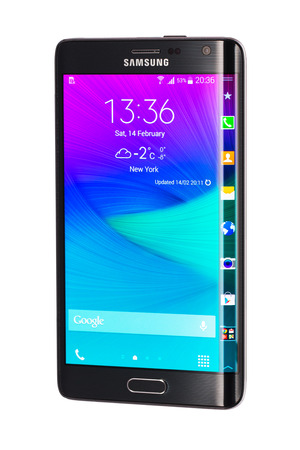 """samsung galaxy: Varna, Bulgaria - February 14, 2015: Studio shot of a black Samsung Galaxy Note Edge smartphone, with 16 mP Camera, quad-core 2,7 GHz and 5.6"""" Curved edge screen display, 1600 x 2560 pixels resolution."""