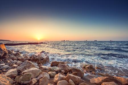 colorful sunrise: Tropical colorful sunrise at the stones beach