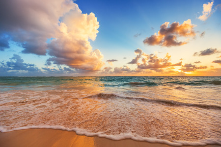dramatic sunrise: Beautiful cloudscape over Caribbean sea, sunrise shot Stock Photo