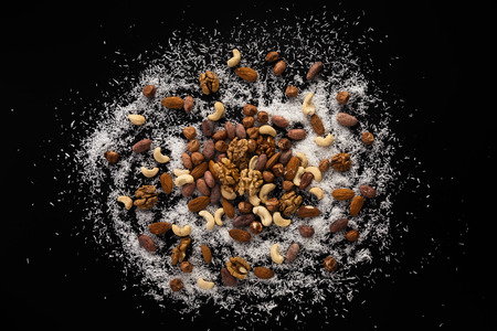 swarf: Hazelnuts, almonds, cacao beans, walnut, cashew and coconuts swarf on the black board
