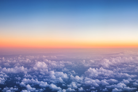 Above The Clouds Photo of puffy clouds, sunset shot Stock Photo