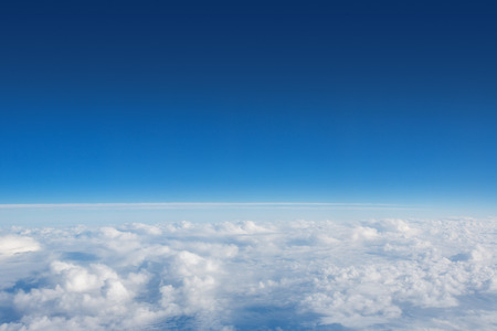 Above The Clouds Photo of puffy clouds