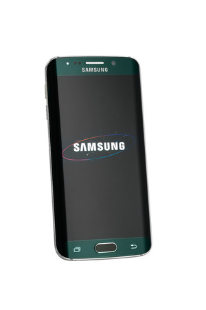 samsung galaxy: Varna Bulgaria  May 26 2015: Studio shot of a green Samsung Galaxy S6 Edge smartphone with 16 mP Camera quadcore 27 GHz and 440 x 2560 pixels Display Resolution with clipping path