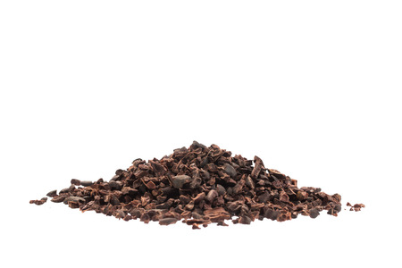 Raw organic cacao nibs on a white background