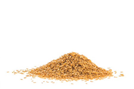 flaxseed: Heap of golden flaxseed or linseed isolated on white background