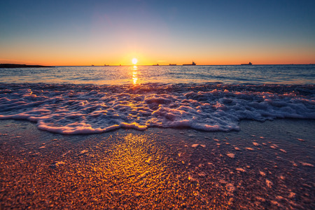 beach panorama: Sunrise over sea, shining waves Stock Photo