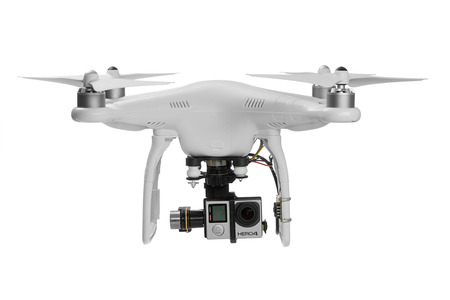 isolated: Varna, Bulgaria - MAY 28 ,2015: Flying drone quadcopter Dji Phantom 2 with digital camera GoPro HERO4 isolated on white Editorial