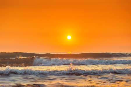 dramatic sunrise: Sunrise and shining waves in ocean, sunrise shot