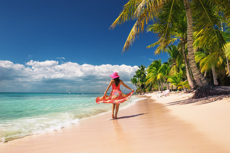 dominican: Carefree, Young woman relaxing on the islands beach Stock Photo