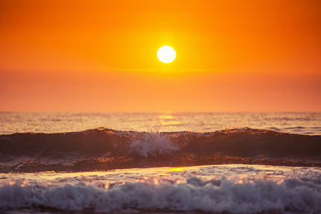 ocean waves: Sunrise and shining waves in ocean, sunrise shot