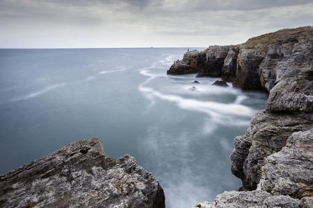sea cliff: The Arch - rock formation near Tyulenovo village, Bulgaria. Long exposure shot.