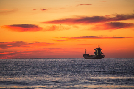 nautical vessels: Fisherman sailling with his boat on beautiful sunrise over the sea