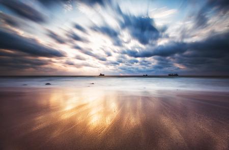 sunrise: Dramatic cloudscape over the sea, sunrise shot Stock Photo