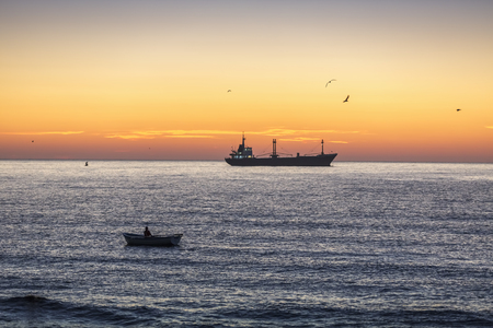 sailling: Fisherman sailling with his boat on beautiful sunrise over the sea