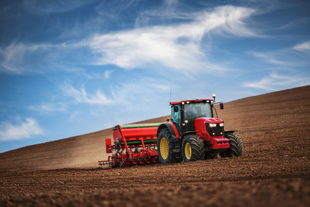sowing: Farmer in tractor preparing farmland with seedbed for the next year