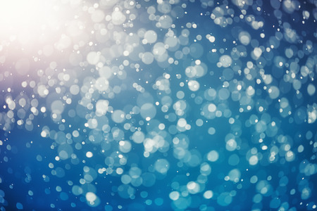 Snow bokeh texture on blue background