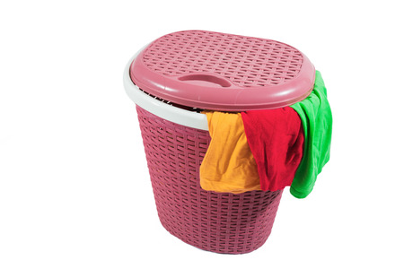 dirty clothes: Plastic laundry basket and dirty clothes isolated on white background