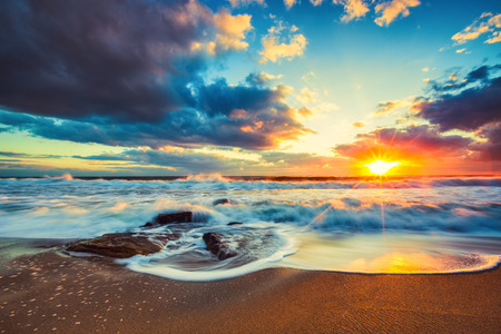 sunny beach: Beautiful cloudscape over the sea, sunrise shot Stock Photo