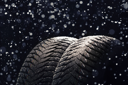 Winter Car tires with snow on black background