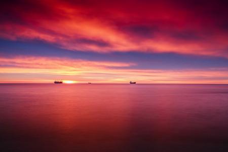 colorful cloudscape: Colorful cloudscape over the sea, sunrise shot Stock Photo