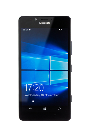 microsoft: Varna, Bulgaria - December 11, 2015: Cell phone model Microsoft Lumia 950 has 20 MP camera, Microsoft Windows 10 os,,Wireless charging and Iris scanner . Announced 2015, October