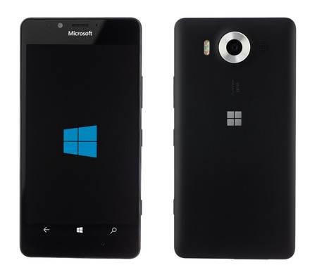 mp: Varna, Bulgaria - December 10, 2015: Cell phone model Microsoft Lumia 950 has 20 MP camera, Microsoft Windows 10 os,,Wireless charging and Iris scanner . Announced 2015, October