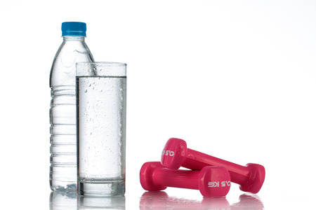 muscle toning: Dumbbells and a bottle of fresh water isolated on white background