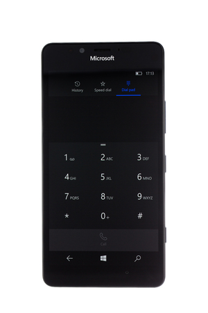 microsoft: Varna, Bulgaria - December 10, 2015: Cell phone model Microsoft Lumia 950 has 20 MP camera, Microsoft Windows 10 os,,Wireless charging and Iris scanner . Announced 2015, October