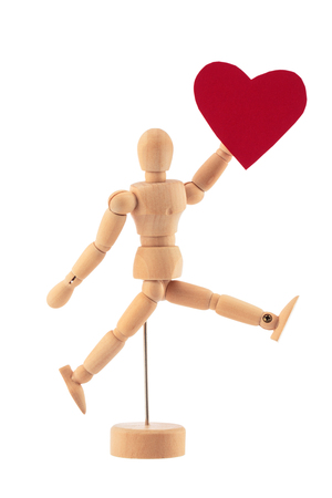 man s: Wooden man toy statue and heart isolated on white background. Valentine's day concept.